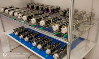 28 Cubesats for Planet Labs' 'Flock 1' Constellation