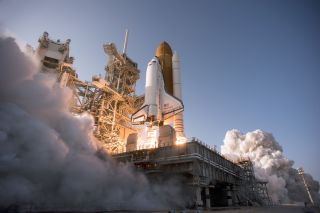 Space shuttle Discovery ignites for liftoff on Launch Pad 39A at NASA's Kennedy Space Center in Florida beginning its final flight, the STS-133 mission, to the International Space Station, on Feb. 24, 2011.