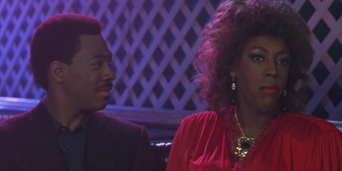 Eddie Murphy as Prince Akeem Joffer and Arsenio Hall as a woman in Coming to America (1988)