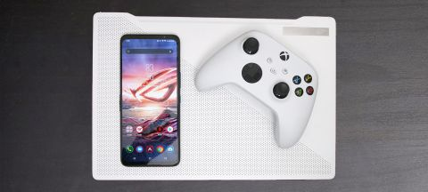 Asus ROG Phone 5 resting on Asus ROG Zephyrus G14 with Xbox Series X controller
