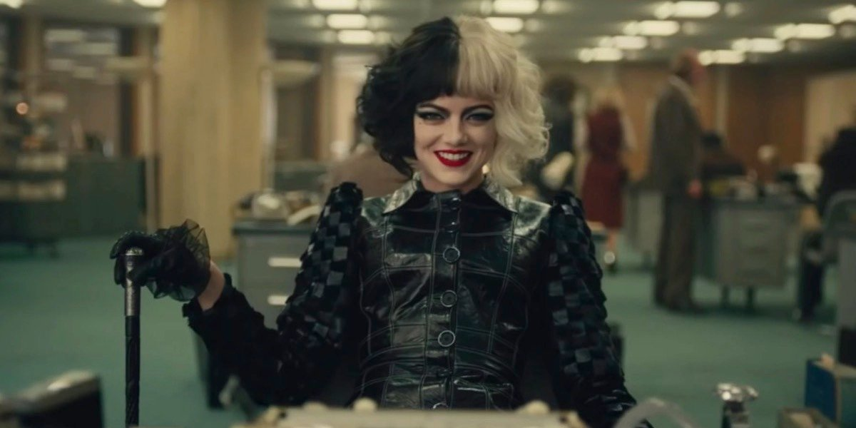 Emma Stone as Cruella in black and a cane in 2021 live-action movie