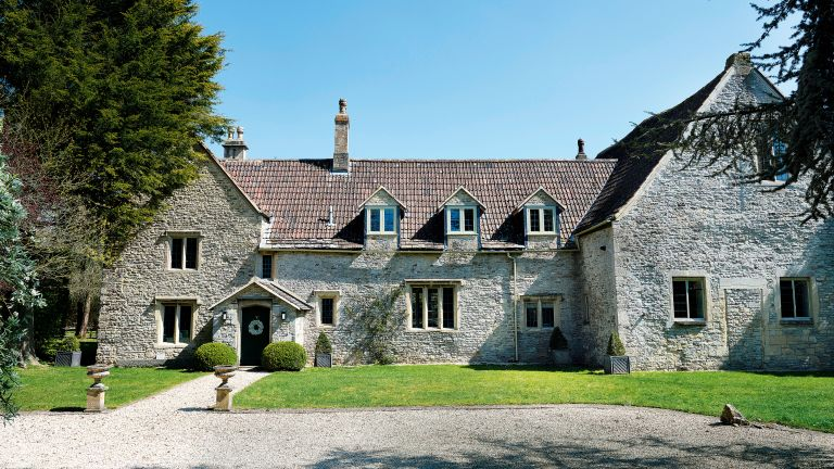 exterior of Grade II* listed 12th century Cotswolds country house