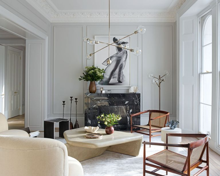 Mass in interior design: White living room with cane and wood chairs