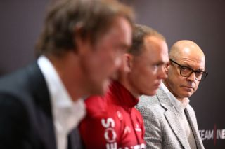 Chris Froome sits between Team Ineos owner Jim Ratcliffe and manager Dave Brailsford