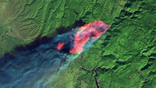 This satellite image, captured on Nov. 8, 2018, by Landsat 8, shows short-wave infrared (red), which gives the full extent of the actively burning area of the Camp Fire, just four hours after it started. The red patches are fires that leapfrogged in front