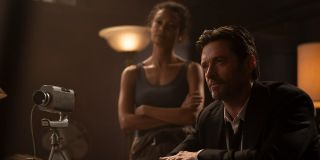 Thandiwe Newton and Hugh Jackman interview a subject in Reminiscence.