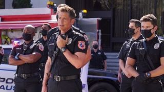 Brian Michael Smith as Paul Strickland, Rob Lowe as Captain Owen Strand and Ronen Rubinstein as T.K. Strand in 9-1-1: Lone Star.