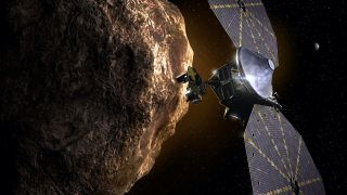 An illustration of the Lucy spacecraft near a Trojan asteroid