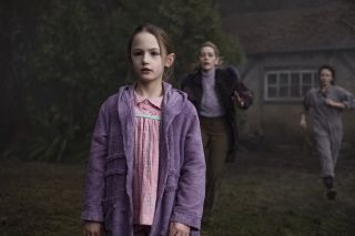 Dani Clayton (Victoria Pedretti) runs toward her daughter as she looks at something presumably spooky.
