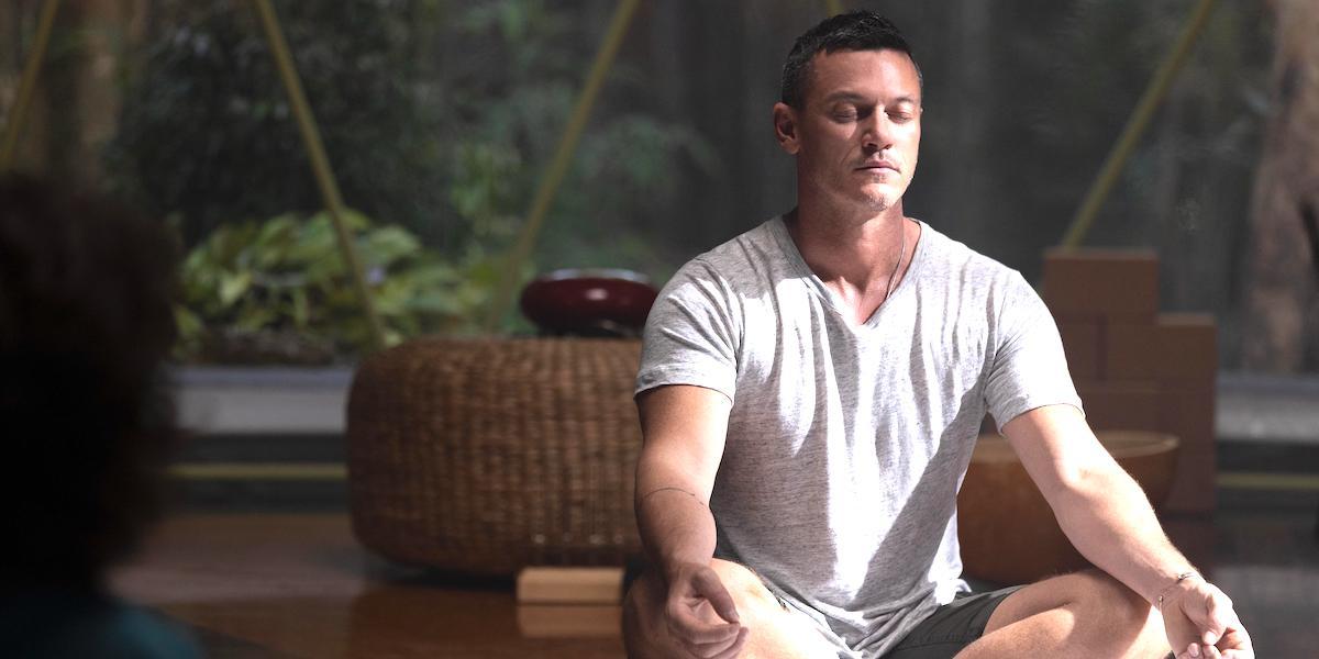 Luke Evans as Lars Lee meditates in Nine Perfect Strangers