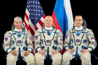 NASA astronaut Mark Vande Hei (left) joins Russian cosmonauts Oleg Novitskiy and Pyotr Dubrov before their launch, currently scheduled for April 9, 2021.