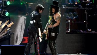 Richard Fortus, Slash and Melissa Reese of Guns N' Roses perform onstage during day 2 of the 2016 Coachella Valley Music & Arts Festival Weekend 2 at the Empire Polo Club on April 23, 2016 in Indio, California