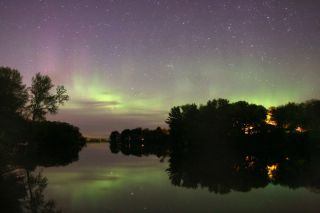 Skywatchers in Wisconsin took this image of green auroras reflecting off the water.