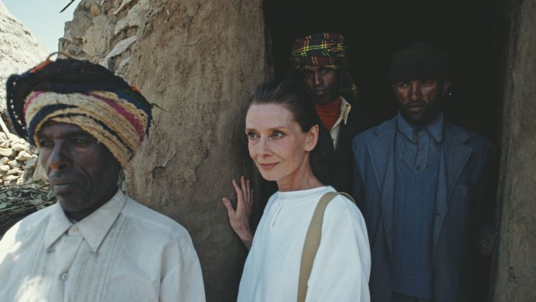 British actress and humanitarian Audrey Hepburn (1929 - 1993) with locals on her first field mission for UNICEF in Ethiopia, 16th-17th March 1988. (Photo by Derek Hudson/Getty Images)