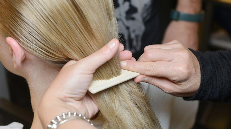 model combing hair