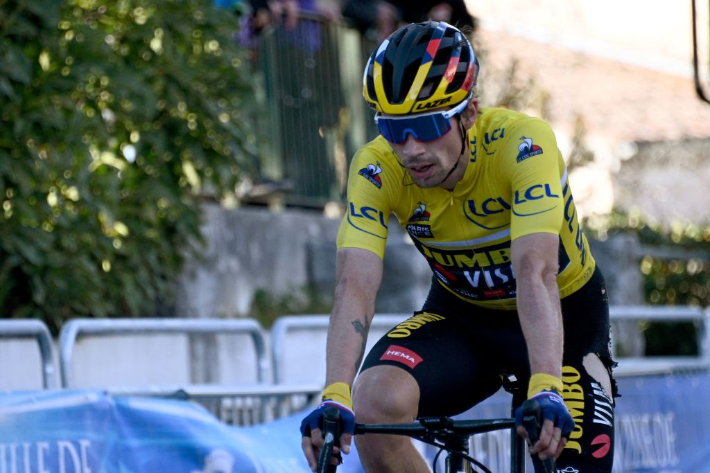 Team Jumbo rider Slovenias Primoz Roglic wearing the overall leaders yellow jersey crosses the finish line of the 8th stage of the 79th Paris Nice cycling race 93 km between Le PlanDuVar and Levens on March 14 2021 Photo by AnneChristine POUJOULAT AFP Photo by ANNECHRISTINE POUJOULATAFP via Getty Images