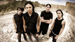 A press shot of Bullet For My Valentine in the Poison era, stood outside on rubble