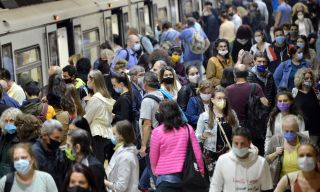 A crowd of people wearing masks at a subway station in Bulgaria.