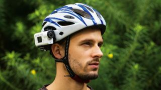 Man with action camera strapped to helmet