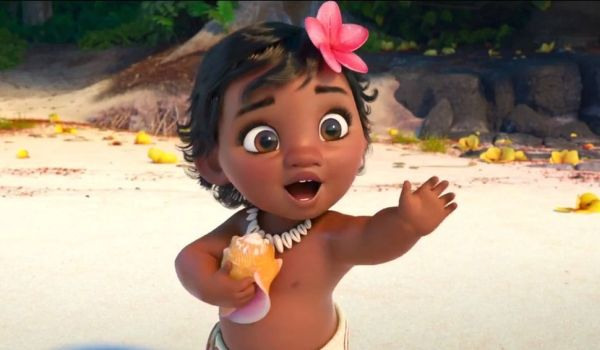 Baby Moana waving at the ocean