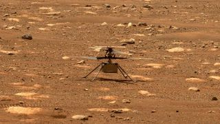NASA's Mars Helicopter Ingenuity is seen by the Perseverance rover after unlocking its rotor blades on April 7, 2021.
