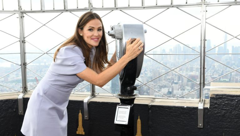 Jennifer Garner, Carolyn Miles, and Mark Shriver light the Empire State Building red in honor of Save the Children's Centennial Gala at The Empire State Building on September 12, 2019 in New York City.