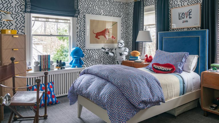Teenage boys bedroom ideas with black and white zigzag wallpaper, a blue velvet headboard and blue blinds