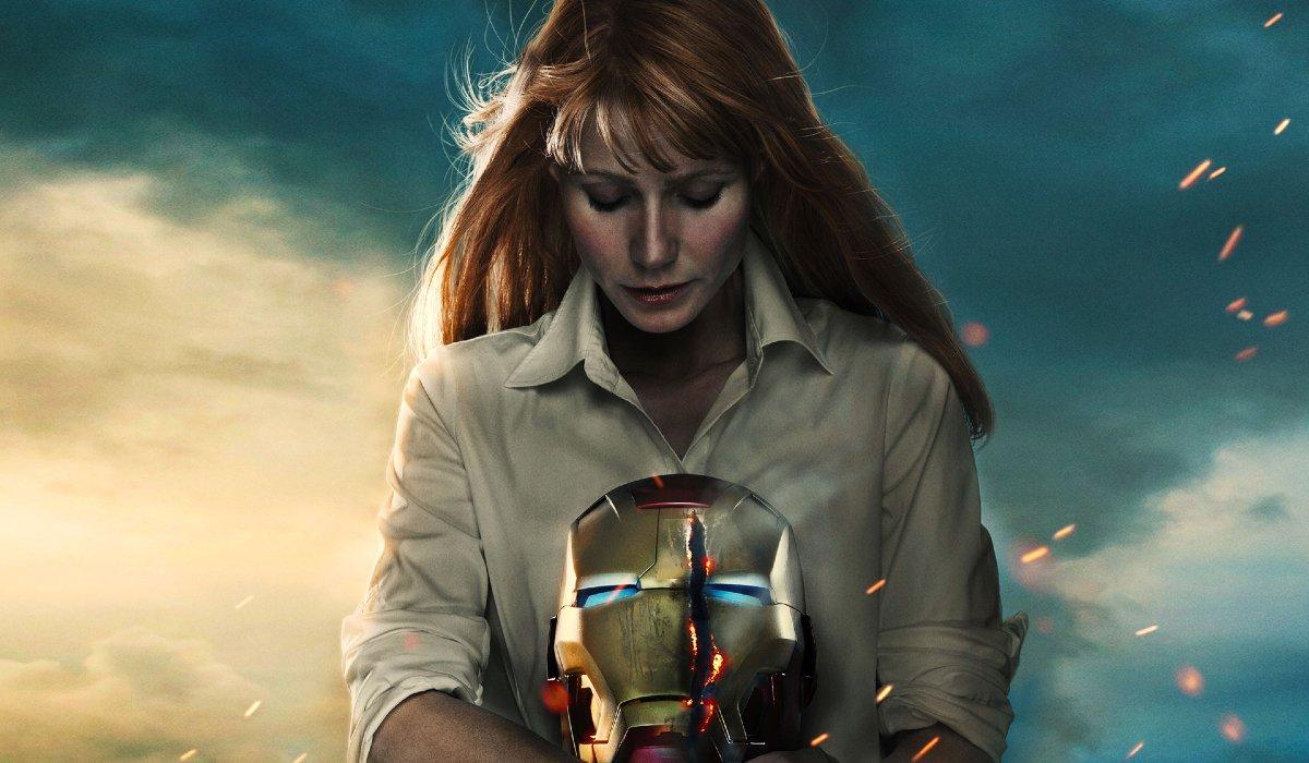 Iron Man 3 Pepper Potts looking at a slashed Iron Man helmet