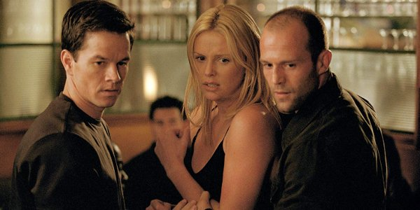 The Italian Job Mark Wahlberg, Charlize Theron, and Jason Statham look down on someone on a restaura