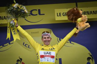 Tadej Pogacar of UAE Team Emirates celebrates on the podium in the yellow jersey of leader in the overall ranking after stage 8 of the 108th edition of the Tour de France