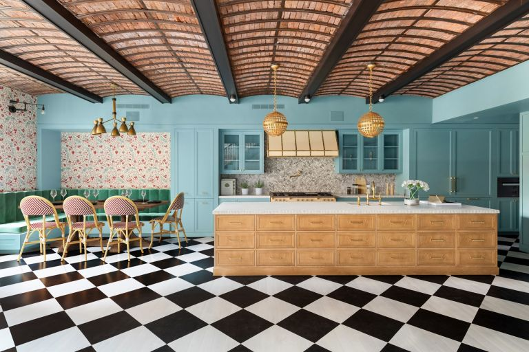 Ken Fulk designed kitchen with floral wallpaper and checked floor