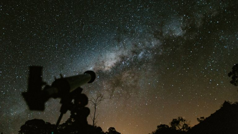 telescope with night sky in the background