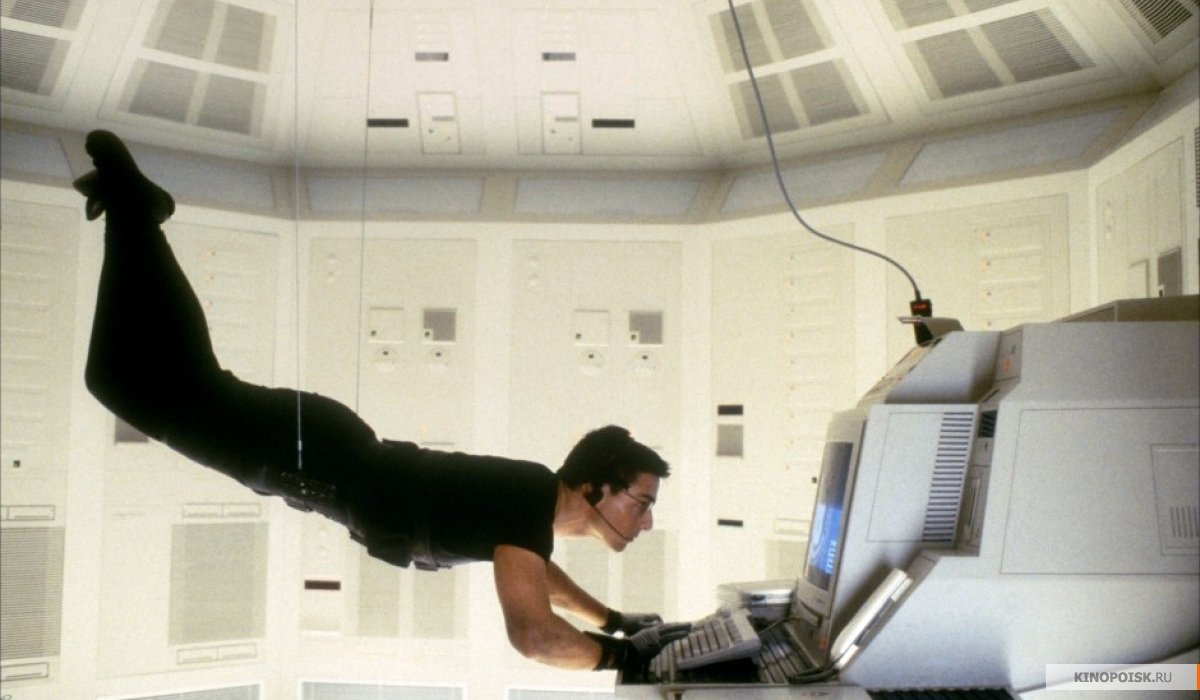 Tom Cruise hanging from the ceiling, while accessing a computer in Mission: impossible