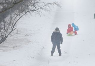 As the Northeast gets pummeled by a blizzard on Tuesday, March 14, 2017, kids take to the streets of Brooklyn for some sledding.