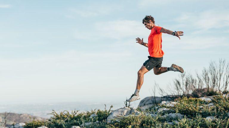 Best running socks: men descending down a hillside
