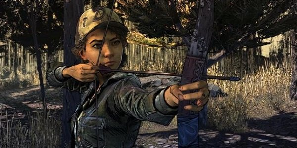 Clementine fires a bow in The Walking Dead.