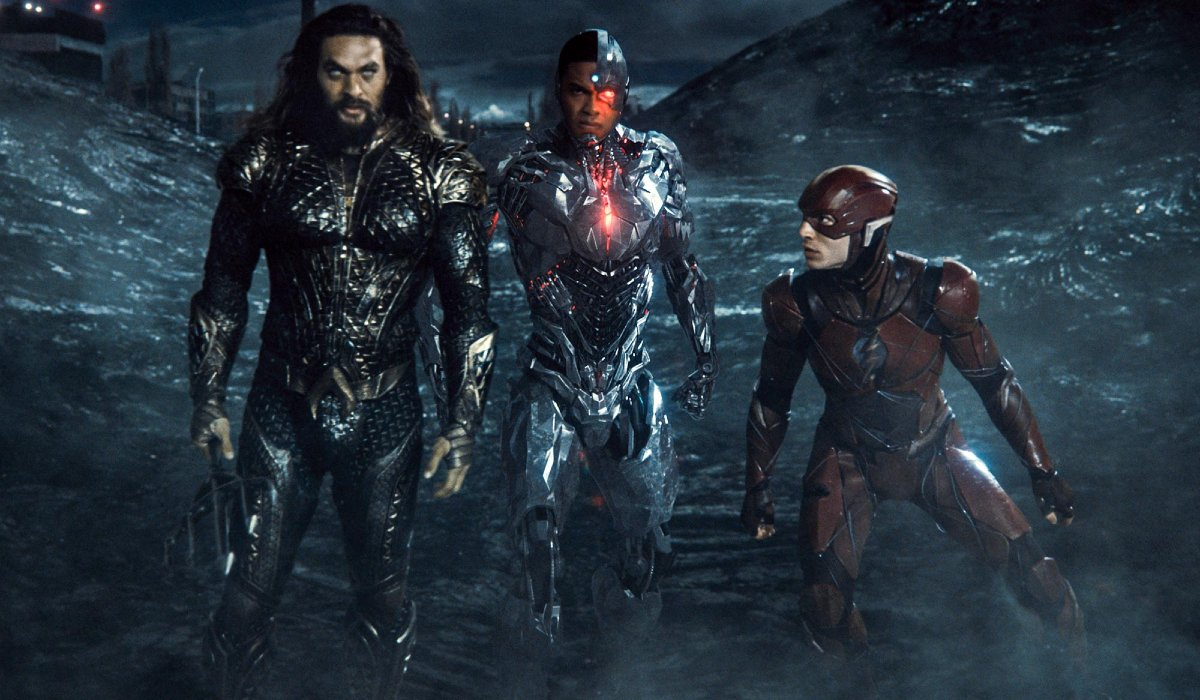 Aquaman, Cyborg, and The Flash standing on the battlefield in Zack Snyder's Justice League.