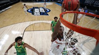 Evan Mobley #4 of the USC Trojans dunks the ball against the Oregon Ducks in the first half of their Sweet Sixteen round game of the 2021 NCAA Men's Basketball Tournament at Bankers Life Fieldhouse on March 28, 2021 in Indianapolis, Indiana.