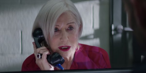 Hobbs and Shaw Queenie talks on the prison phone in her red jumpsuit