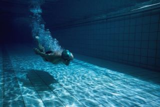 A swimmer under water