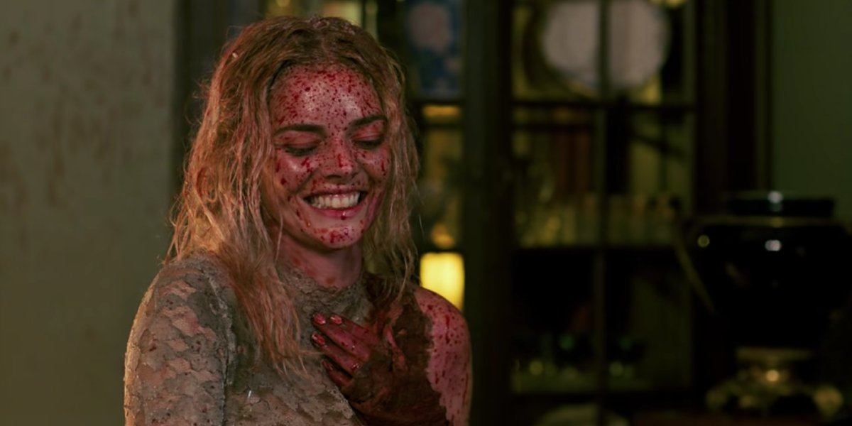 Blood-soaked and smiling Samara Weaving in Ready or Not