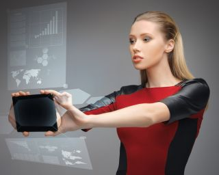 A futuristic looking woman studies a hologram on a tablet screen.