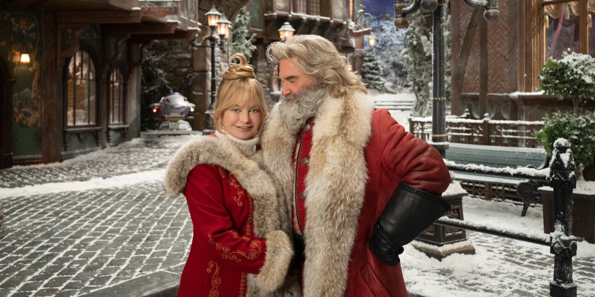 The Christmas Chronicles 2 Goldie Hawn and Kurt Russell standing in the middle of their village