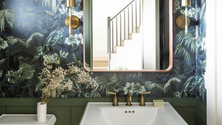 Olive green bathroom with wallpaper and white sink