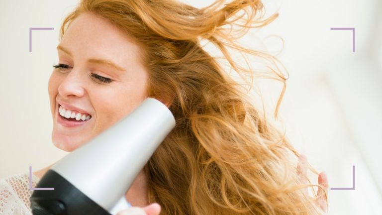 how to blow-dry hair main image of woman blow-drying own hair