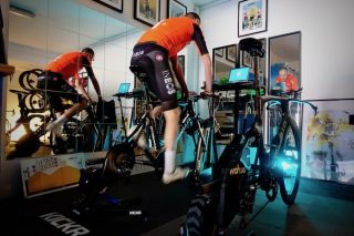 Chris Froome (Team Ineos) starts a Zwift session in his road bike, while his time-trial waits patiently for its turn