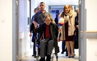 ir Ken Dodd tickled pink as he leaves hospital after six-week stint