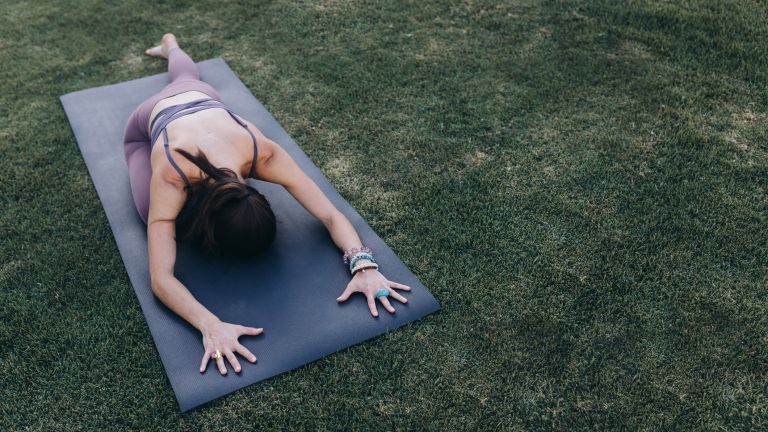 Woman doing a hip stretch outdoors