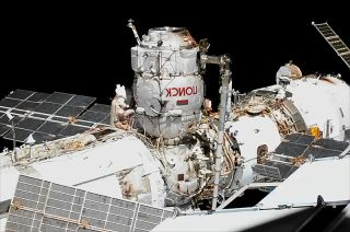 Cosmonaut Sergey Ryzhikov, Expedition 64 commander, is seen at the base of the Poisk mini-research module during a Nov. 18, 2020 spacewalk outside the International Space Station that inaugurated the use of Poisk as an airlock.