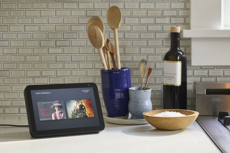 Amazon Echo Show 8 on kitchen counter near utensils and bottle of oil